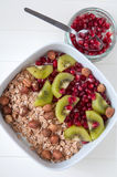 Yoghurt with kiwi and pomegrante seeds Stock Image