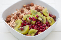 Yoghurt with kiwi and pomegrante seeds Stock Photos