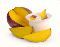 Yoghurt with mango and pieces Stock Photos