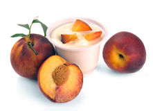Yoghurt with peach and pieces Royalty Free Stock Images