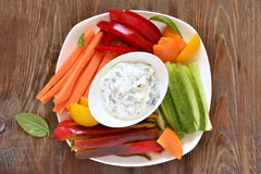 Yoghurt sauce with garlic and basil with fresh vegetables Royalty Free Stock Photography