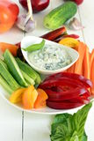 Yoghurt sauce with garlic and basil with fresh vegetables Stock Photos