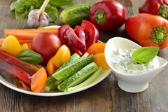 Yoghurt sauce with garlic and basil with vegetables Stock Photos