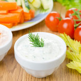 Yoghurt sauce with herbs to assorted fresh vegetables Stock Images