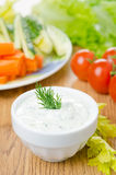 Yoghurt sauce with herbs to assorted fresh vegetables close-up Royalty Free Stock Images