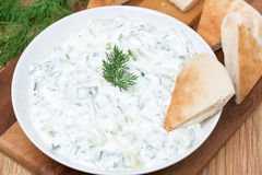 Yoghurt sauce tzatziki with herbs, cucumber and garlic, top view Stock Images