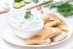 Yoghurt sauce tzatziki with pieces of pita bread Stock Photos