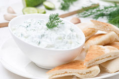 Yoghurt sauce tzatziki with pieces of pita bread, close-up Stock Photo