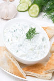 Yoghurt sauce tzatziki with pieces of pita bread, top view Royalty Free Stock Photography