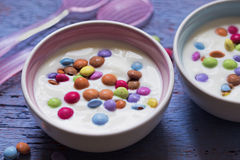 Yoghurt with smarties. In bowls Royalty Free Stock Photo