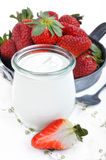 Yoghurt and strawberries Stock Photos