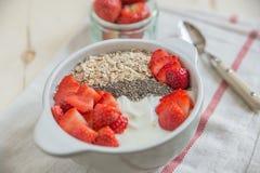 Yoghurt with strawberries and granola Stock Photo