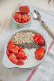 Yoghurt with strawberries and granola Stock Photography
