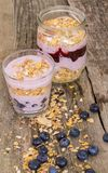 Yoghurt on the table. Food. Delicious yoghurt with muesli on the table royalty free stock image