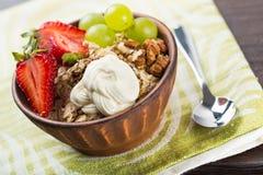 Yoghurt. Yogurt cup pastel fruit closeup table royalty free stock photos