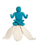 Yogi. Plasticine yogi sit on lotus isolated on white stock photos