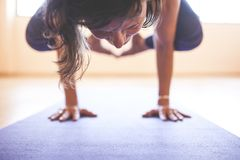 Woman doing yoga at wooden floor Stock Image
