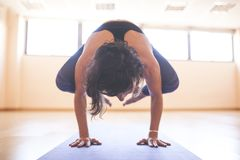 Woman doing yoga at wooden floor Royalty Free Stock Photos
