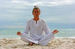 Yogi on the beach Stock Photos