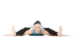 Yogi female bends forward in yoga asana Turtle Pose Royalty Free Stock Photo