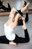 Yogi female doing backbends exercising in class Stock Photo