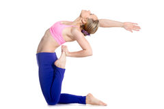 Yogi female doing one-legged Camel Pose Stock Image