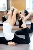 Yogi female exercising in class stock photos