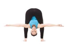 Yogi female in yoga asana bends forward Royalty Free Stock Photography