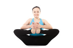 Yogi female in yoga asana Kandasana Stock Photo