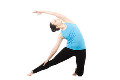 Yogi female in yoga asana Parighasana Royalty Free Stock Photography