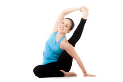 Yogi female in yoga asana Parivritta Kraunchasana, Heron Pose Royalty Free Stock Image