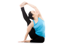 Yogi female in yoga asana Parivritta Surya Yantrasana, Compass P Stock Photography