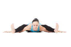 Yogi female in yoga asana Tortoise Pose Royalty Free Stock Image