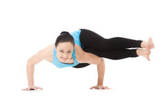Yogi female in yoga asana Two-Legged Koundinya's Pose Stock Photos