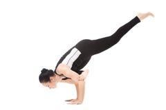 Yogi female in yoga Flying Pigeon Pose Stock Photos