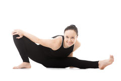 Yogi female in yoga Head to Knee Forward Bend Pose Stock Images