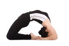Yogi female in yoga Pigeon Pose Stock Photo