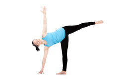Yogi female in yoga Pose Ardha Chandrasana Royalty Free Stock Image