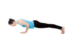 Yogi female in yoga pose Chaturanga Dandasana Stock Image