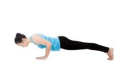 Yogi female in yoga pose Chaturanga Dandasana Stock Image