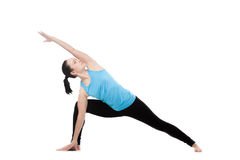 Yogi female in yoga Pose uthitta parshvakonasana Royalty Free Stock Photos