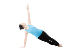 Yogi female in yoga Side Plank Pose royalty free stock photo