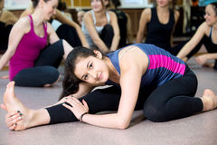 Yogi girl exercising in class Stock Images