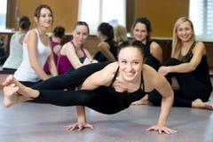 Yogi girl exercising, doing ashtavakrasana, handstand push-ups Royalty Free Stock Image