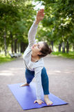 Yogi girl in Extended Side Angle Pose Royalty Free Stock Photos