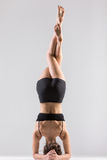 Yogi girl in headstand, asana Sirsasana, Shirshasana, Sirshasana Royalty Free Stock Photo