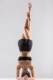 Yogi girl in headstand, asana Sirsasana, Shirshasana, Sirshasana. Sporty girl doing Supported Headstand, yoga asana Sirsasana, Shirshasana, Sirshasana, Headstand Royalty Free Stock Photo