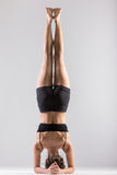 Yogi girl in headstand, asana Sirsasana, Shirshasana, Sirshasana Stock Photos