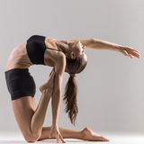 Yogi gymnast girl doing asana Ustrasana or Camel Pose Stock Photography