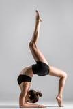 Yogi gymnast girl performs acrobatic exercise stock photography